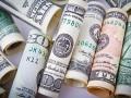 مؤشر الدولار الأمريكي يقلص خسائره ويتجه نحو المنطقة الإيجابية