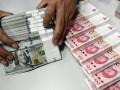 سعر اليوان الصيني يتراجع مقابل الدولار
