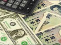 الين اليابانى مقابل الدولار يلامس مستويات الـ 124.40