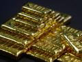 أوقية الذهب تعود للتداول أسفل الترند