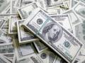 الدولار تحت الضغط بدعم من تعليقات ترامب والين يرتفع متأثرا بتقارير بنك اليابان