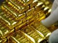 اوقية الذهب تتراجع مع بداية الافتتاح