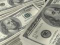 الدولار الامريكي يتداول بالقرب من اعلى مستوياته فى اسبوعين