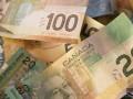 زوج الدولار كندي يصحح من قمم عام وينزلق أدنى مستوى 1.3300