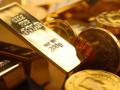 أوقية الذهب تعلن الهبوط وتتداول ما دون مستويات 1300 دولارا