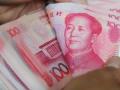 اليوان الصينى يواصل الانزلاق مقابل الدولار والبنك المركزي الصيني يسعى لتخفيض نسبة احتياطي البنك