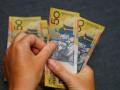 الدولار الاسترالى واليوان يرتفعان الى اعلى مستويات فى اربعة اشهر