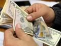 سعر الدولار الأمريكي يتراجع مع توترات بشأن النمو العالمى