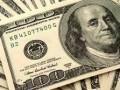 تراجع الدولار مع الحذر من حرب الرسوم الجمركية