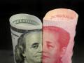 اليوان الصيني يتراجع بسبب التوترات التجارية