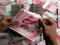 اليوان الصيني يتراجع في مقابل الدولار الامريكي