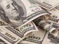 الدولار الأمريكي يتراجع مع تنامى أزمة التجارة