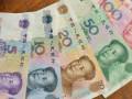 اليوان الصيني يتذبذب بدعم من تعليقات ترامب