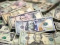 الدولار الأمريكي يتراجع بدعم من الهدنة الأمريكية