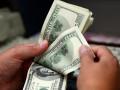 اسعار الدولار لا تزال مستقرة مع تنامى الازمة التجارية