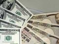 الدولار ين يكافح نحو البقاء