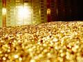 أوقية الذهب تلامس مستويات قياسية