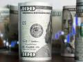 الدولار الأمريكي يتراجع مع تلميحات الاحتياطي الفيدرالي