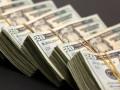 الدولار الأمريكي يتراجع مع ترقب لقرار الفائدة