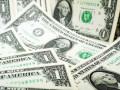 الدولار الامريكي يقترب من ادنى مستوياته مع تنامى التوترات التجارية